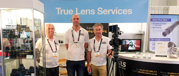 TLS engineers in front of their booth at NAB